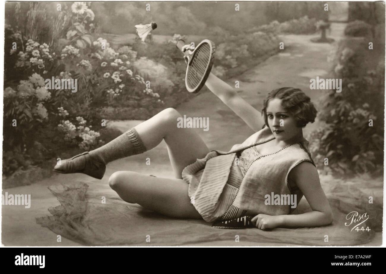 Reclining Woman Playing Badminton, French Postcard, circa 1910 - Stock Image