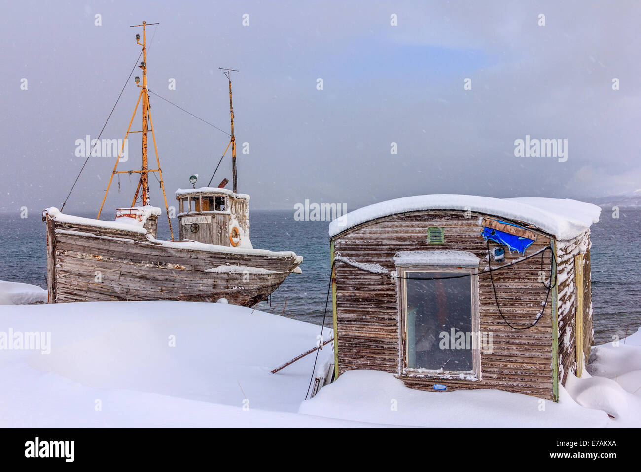 Fishing boat at winter time - Stock Image