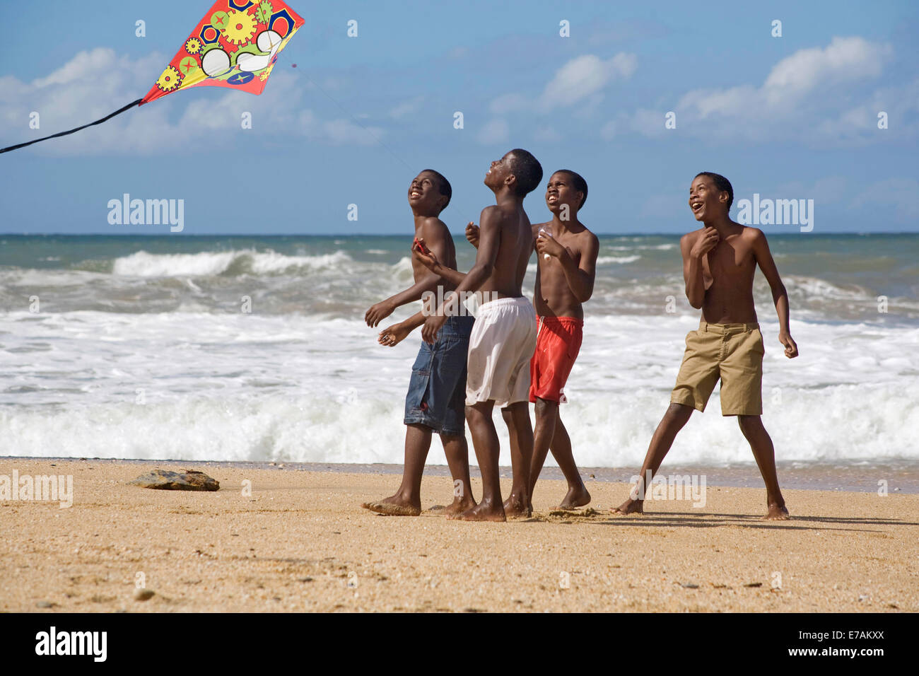 Boys kite-flying at Easter on the beach at Blanchisseuse Stock Photo