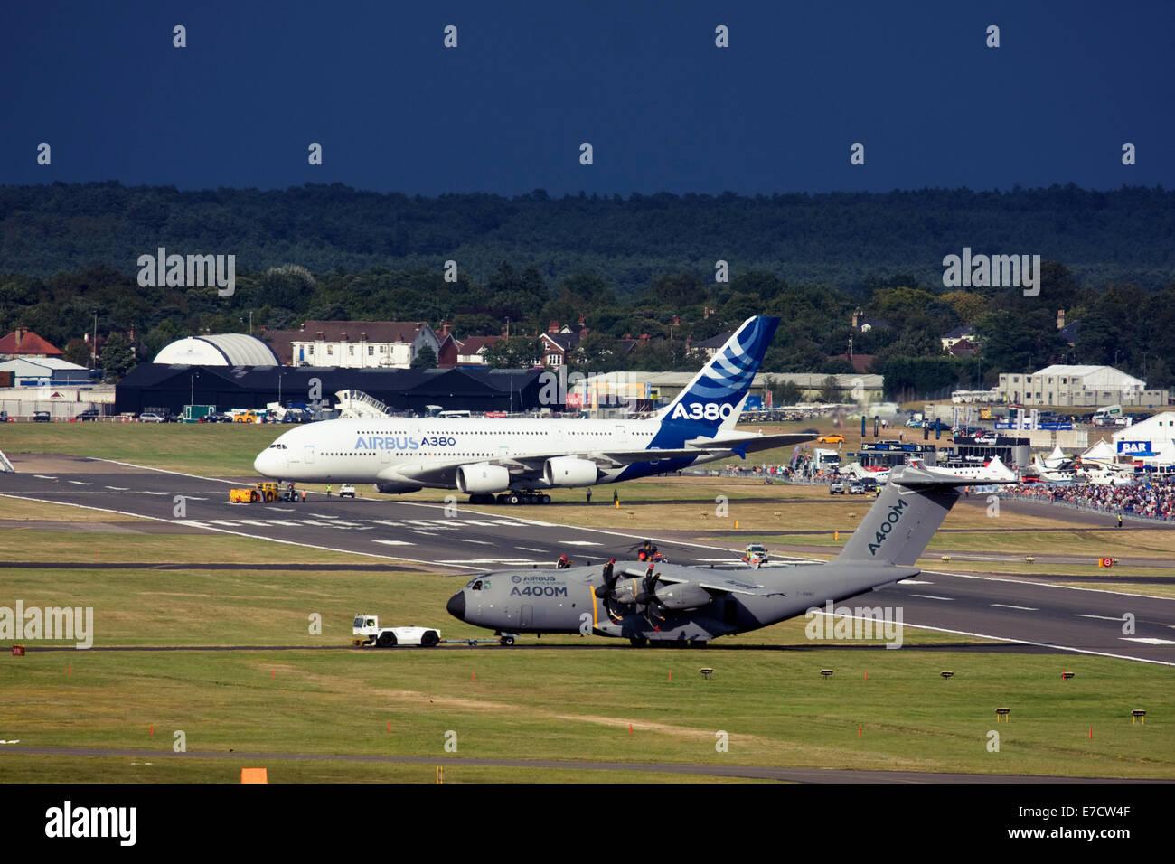 Airbus A380-841 and Airbus A400M Atlas at Farnborough International Airshow 2014 - Stock Image