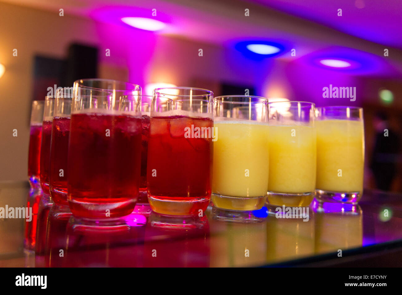 Non-alcoholic choices of drink at an event. Cranberry juice and orange juice. - Stock Image
