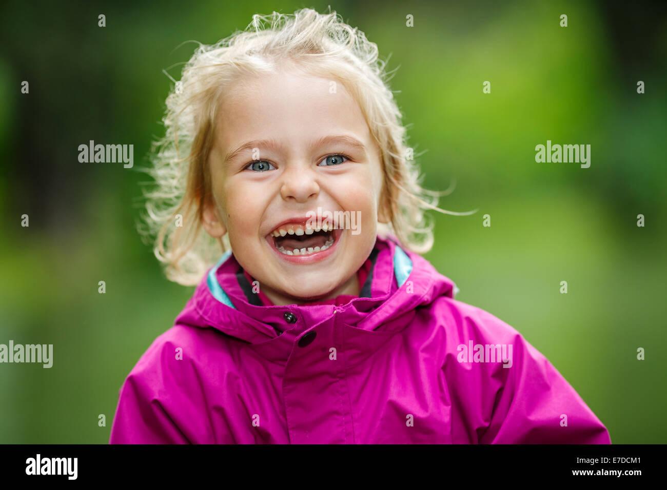 Happy little girl - Stock Image