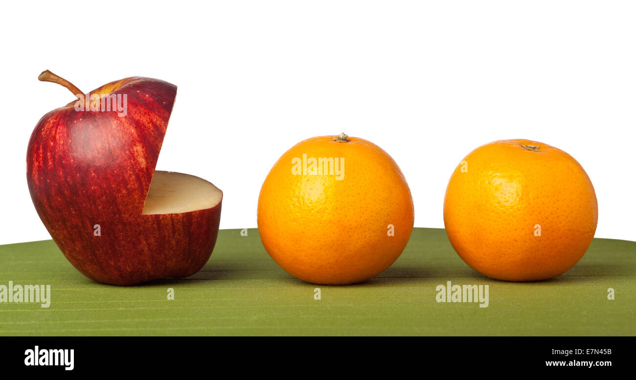 Metaphor of apple monster going after oranges - Stock Image
