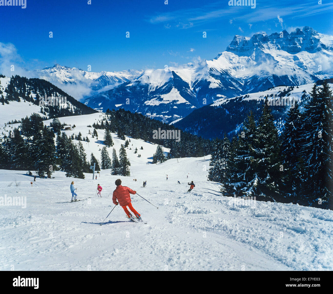 skiers and dents du midi mountains morgins ski resort swiss alps