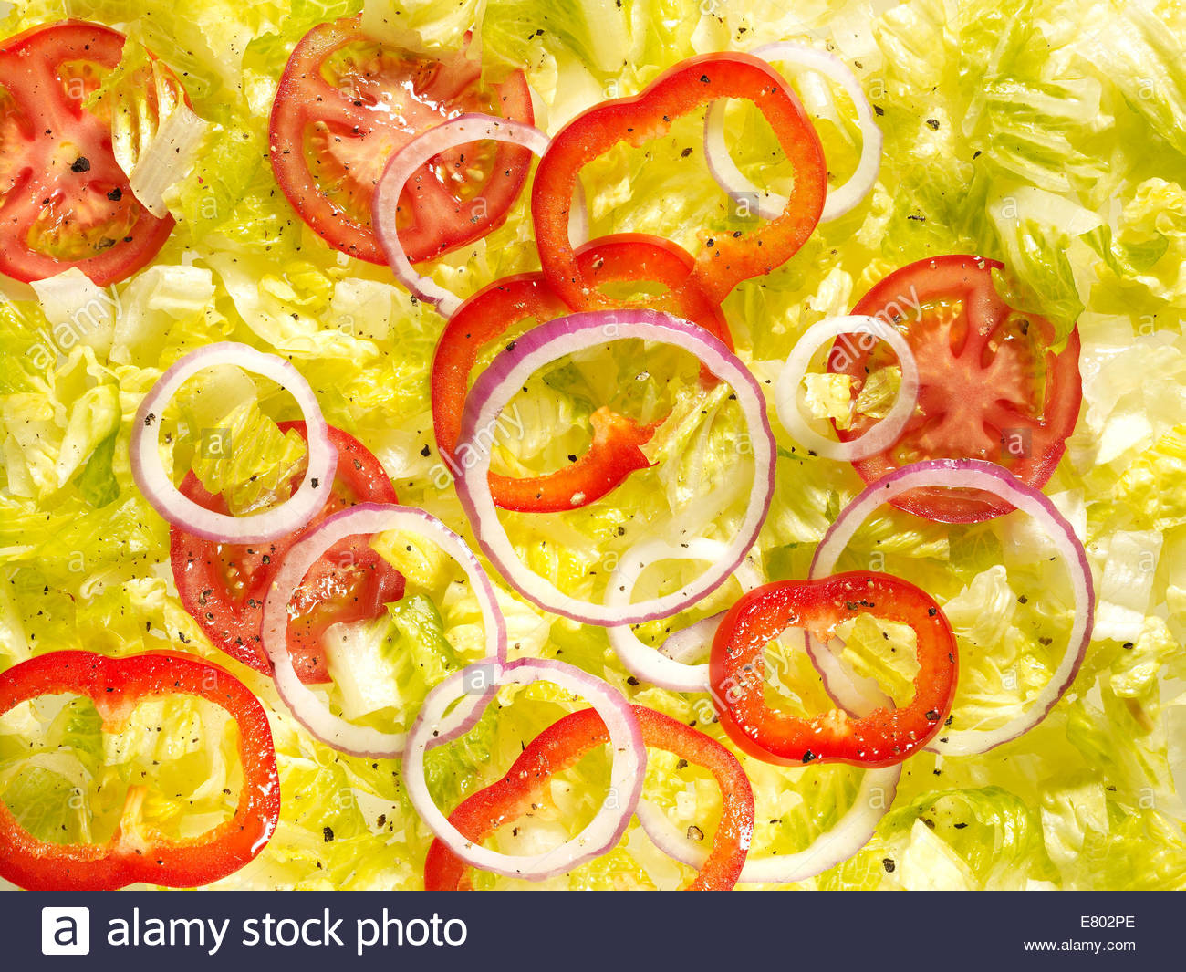 fresh vegetable salad of lettuce, tomato & onions - Stock Image