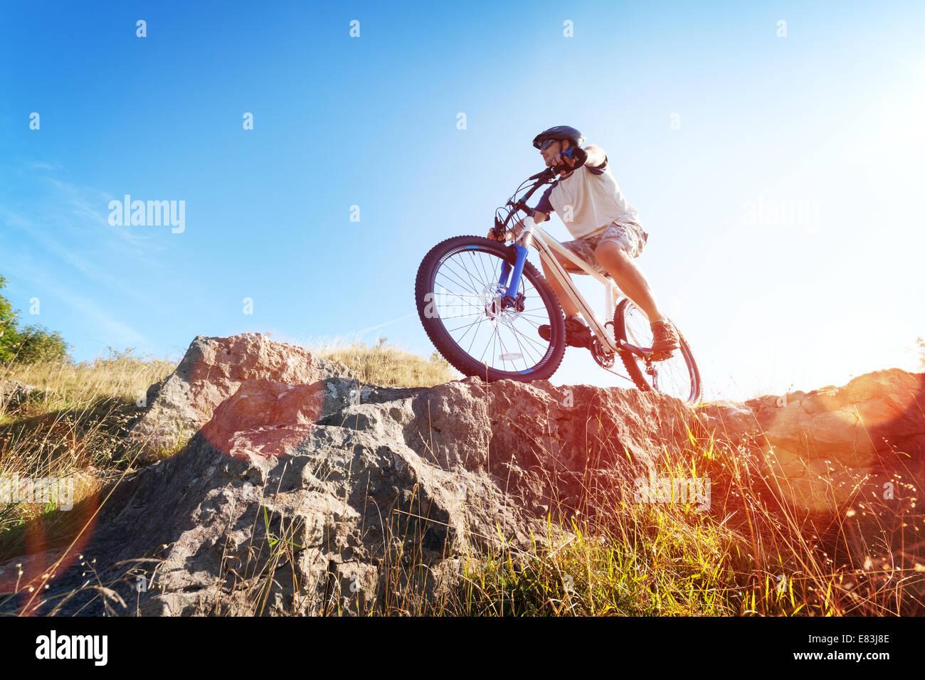 Mountain biker in action - Stock Image