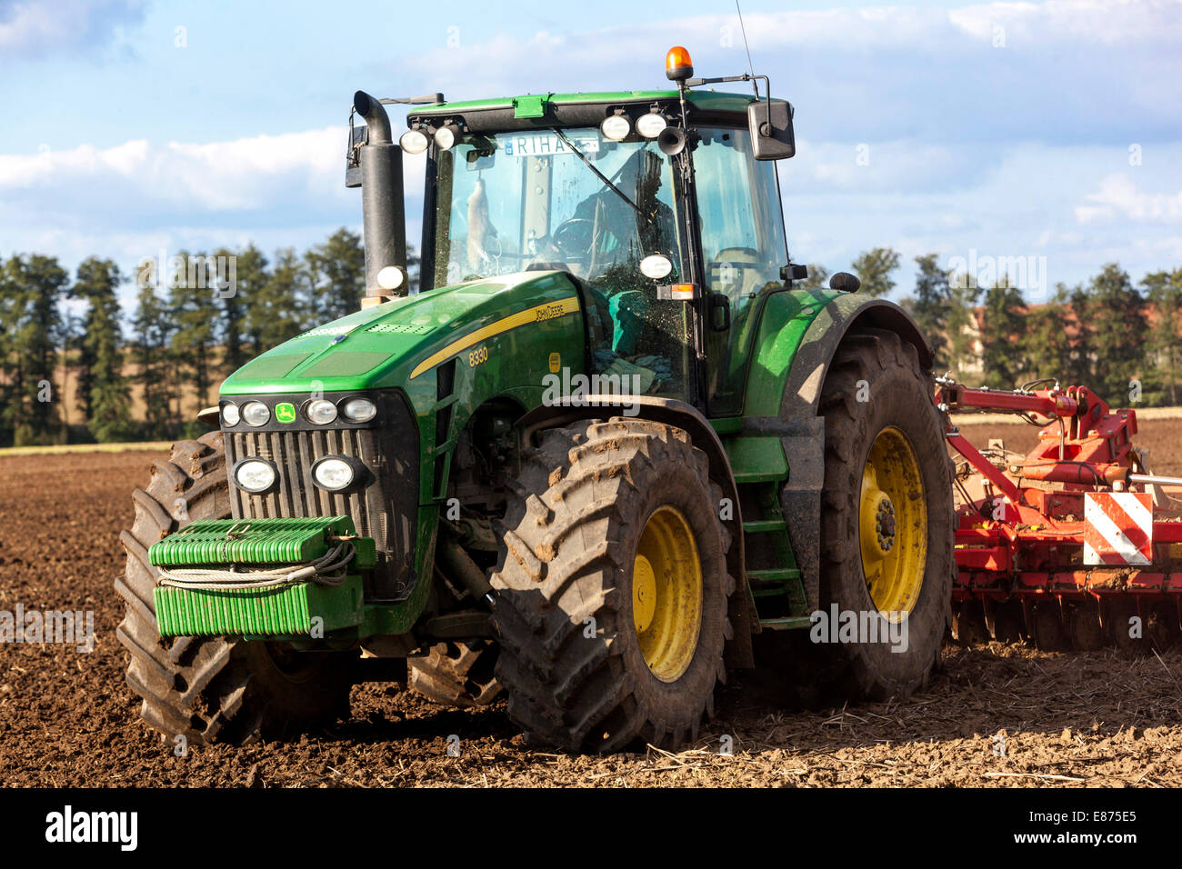 Autumn agro-technical work, tractor plowing the land in the field, Czech Republic - Stock Image