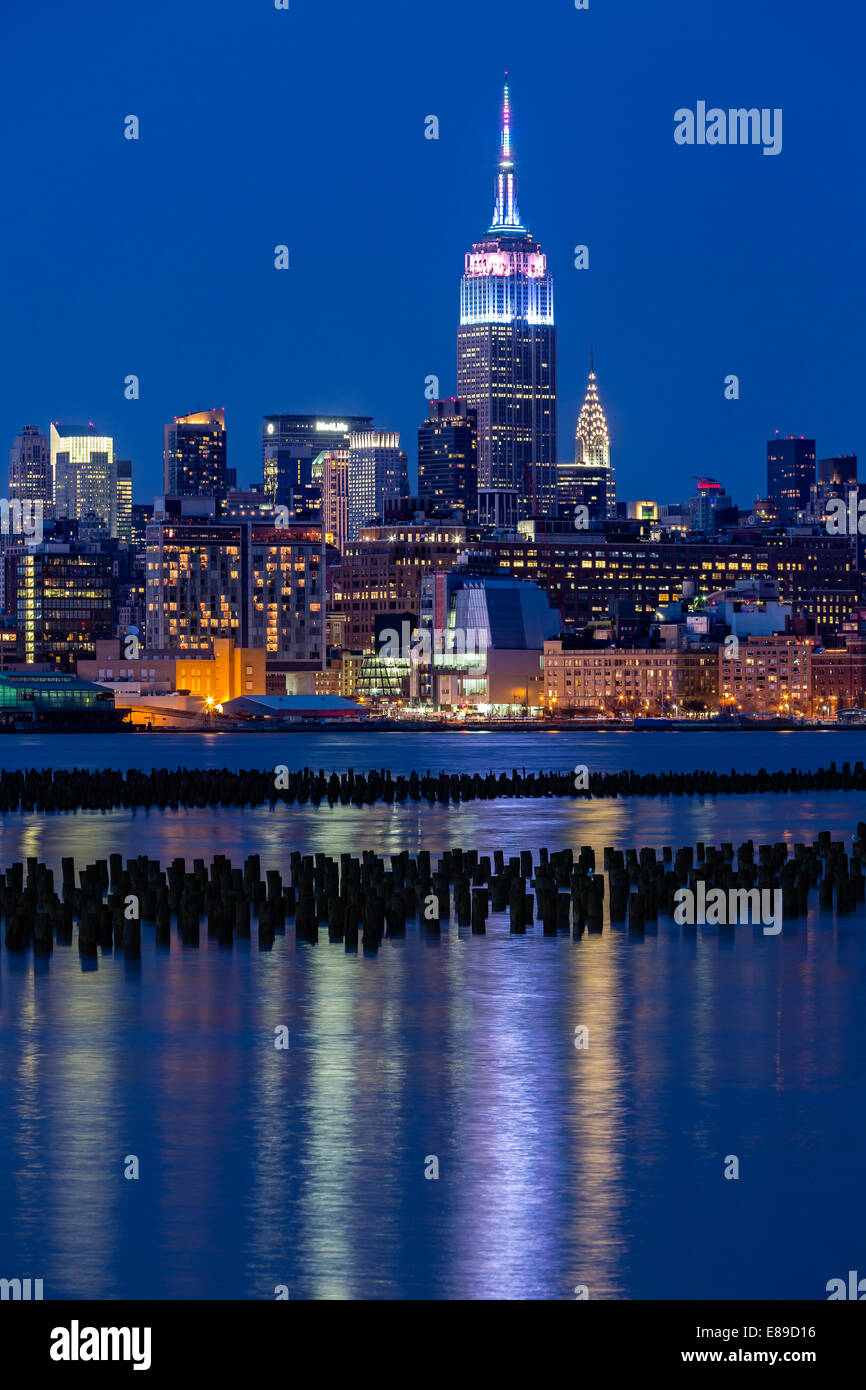 Empire State Building Lights Up To Mark The Easter Holiday In Pastel Fades  Colors, During The Blue Hour At Twilight.