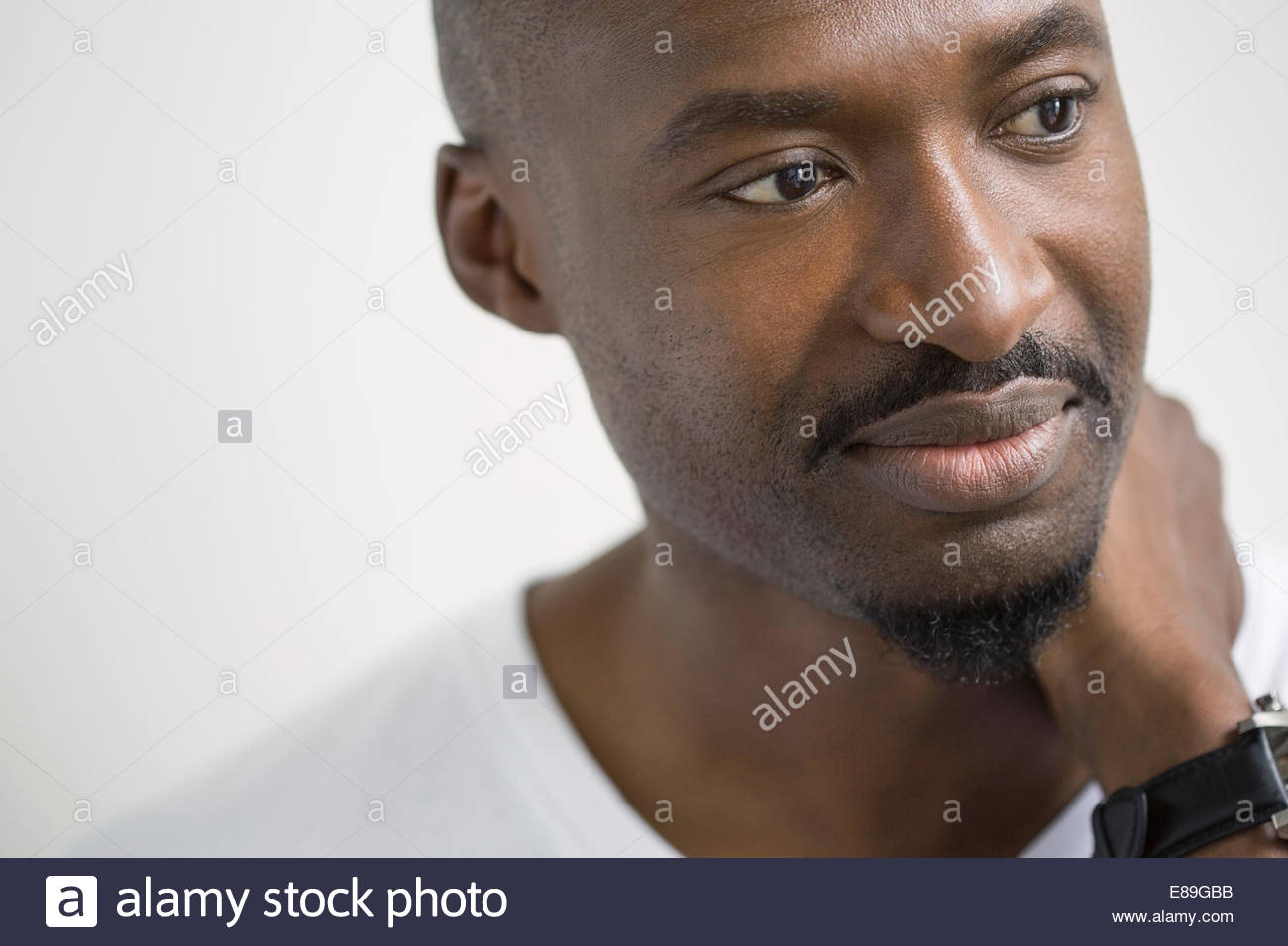 Close up portrait of pensive man looking away - Stock Image