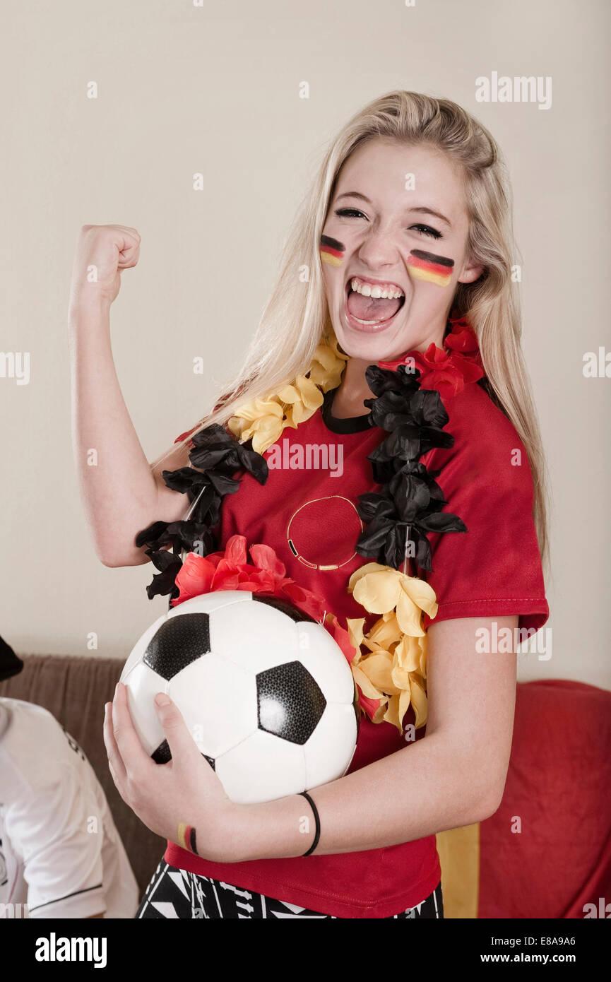 Portrait of female teenage soccer fan - Stock Image