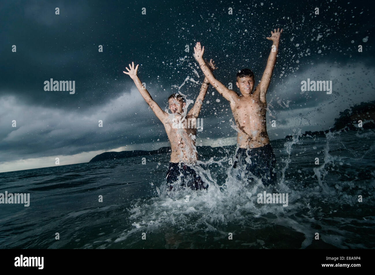 two boys having fun in ocean, Lankawi, Malaysia - Stock Image
