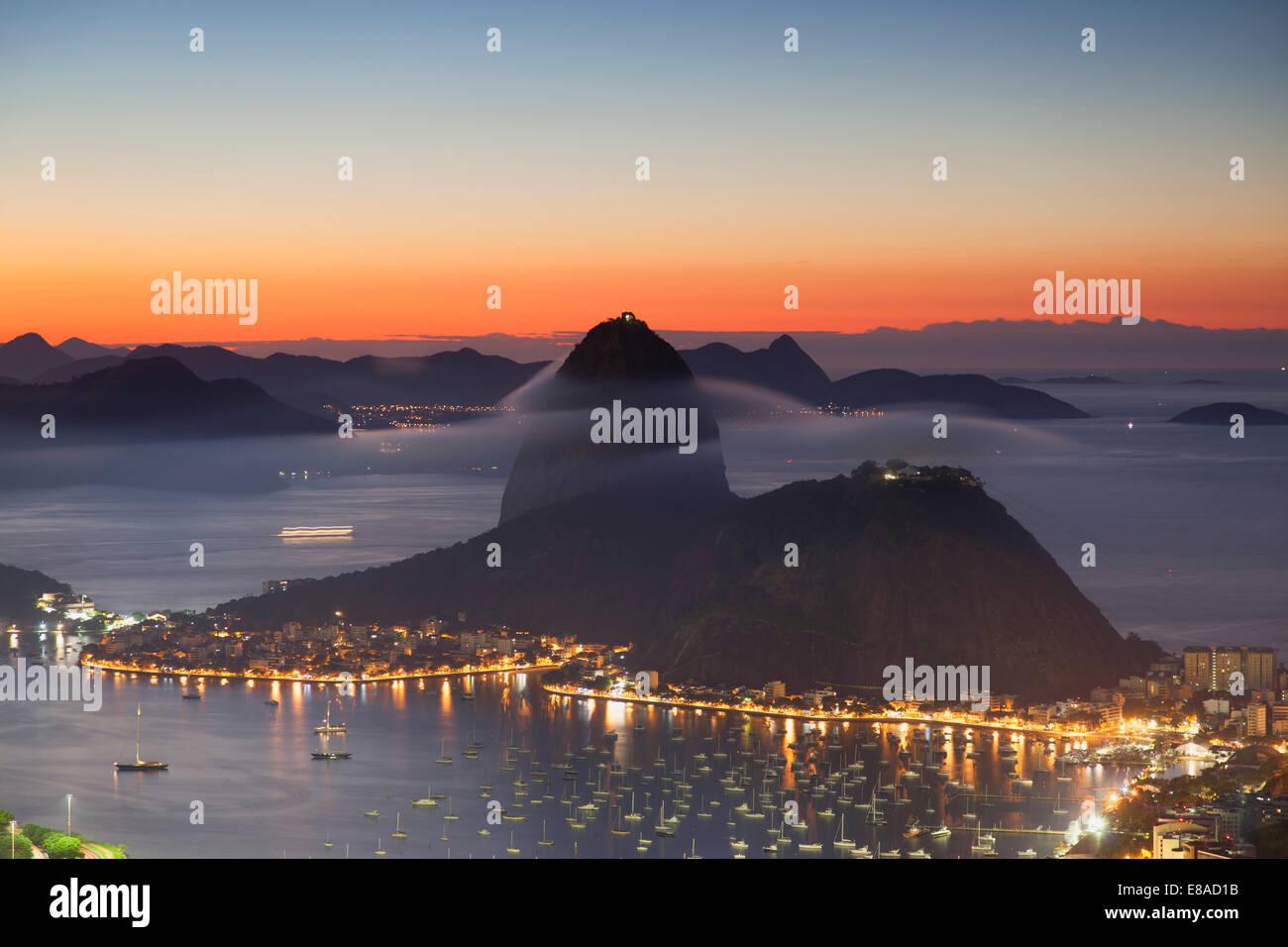 View of Sugarloaf Mountain and Botafogo Bay at dawn, Rio de Janeiro, Brazil - Stock Image