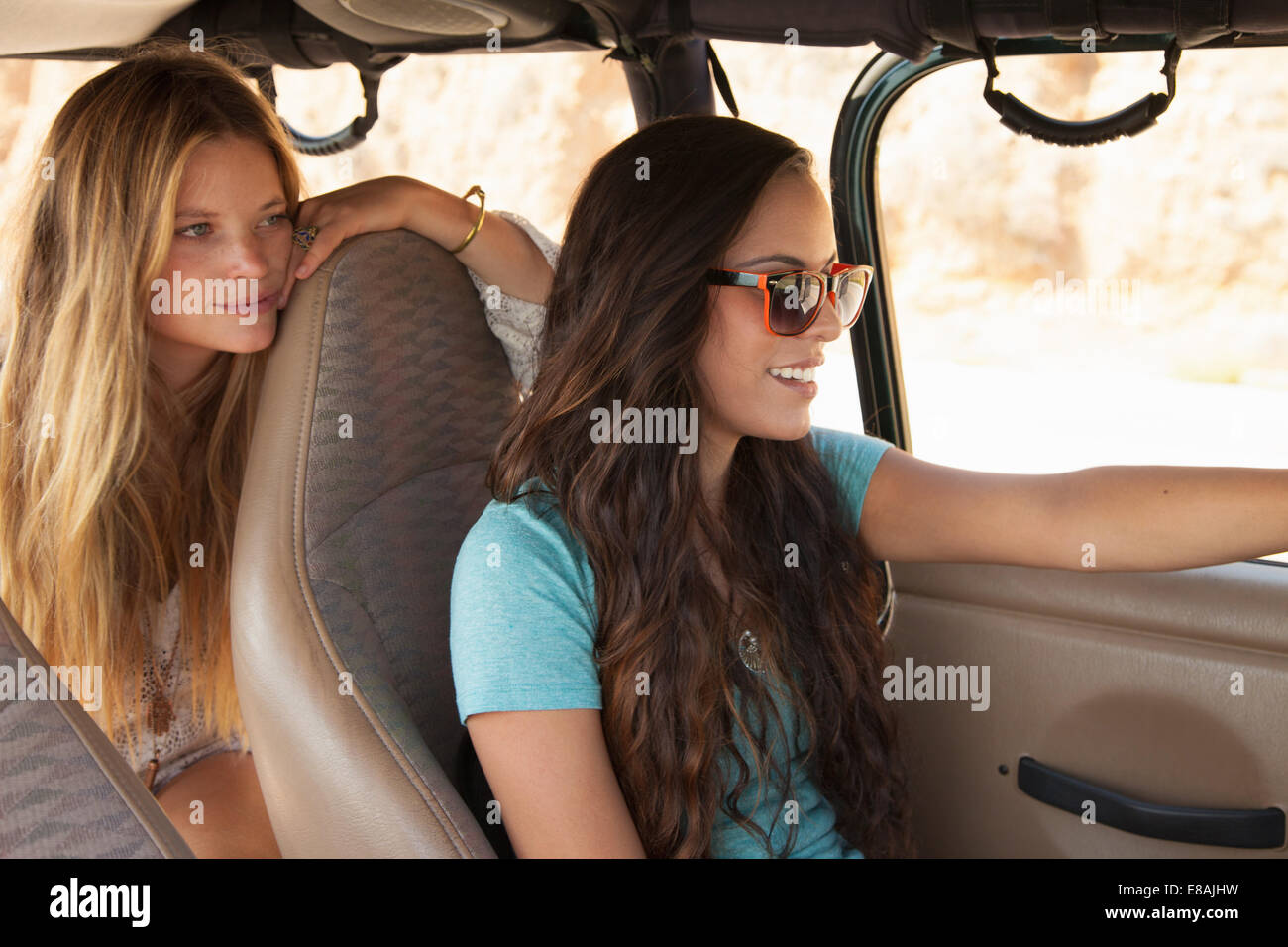 Two young women traveling in car - Stock Image