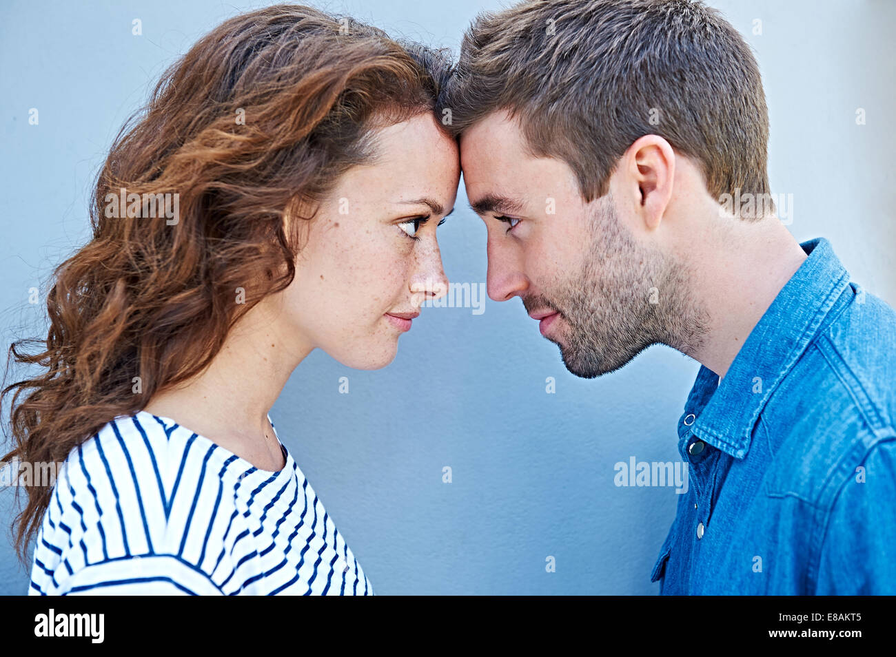 Close up of couple forehead to forehead Stock Photo