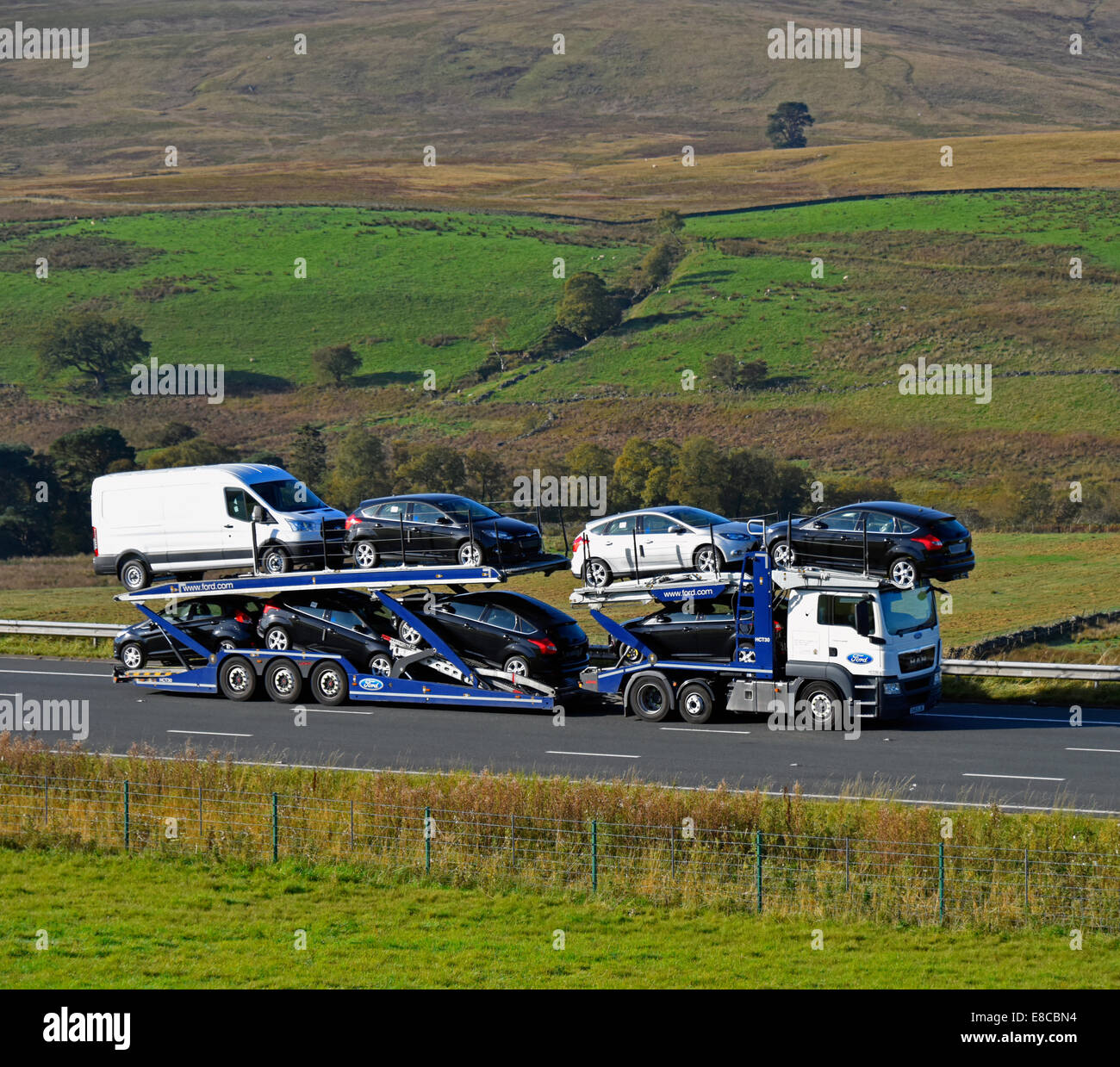 Ford car transporter. M6 Motorway, northbound. Shap, Cumbria, England, United Kingdom, Europe. Stock Photo