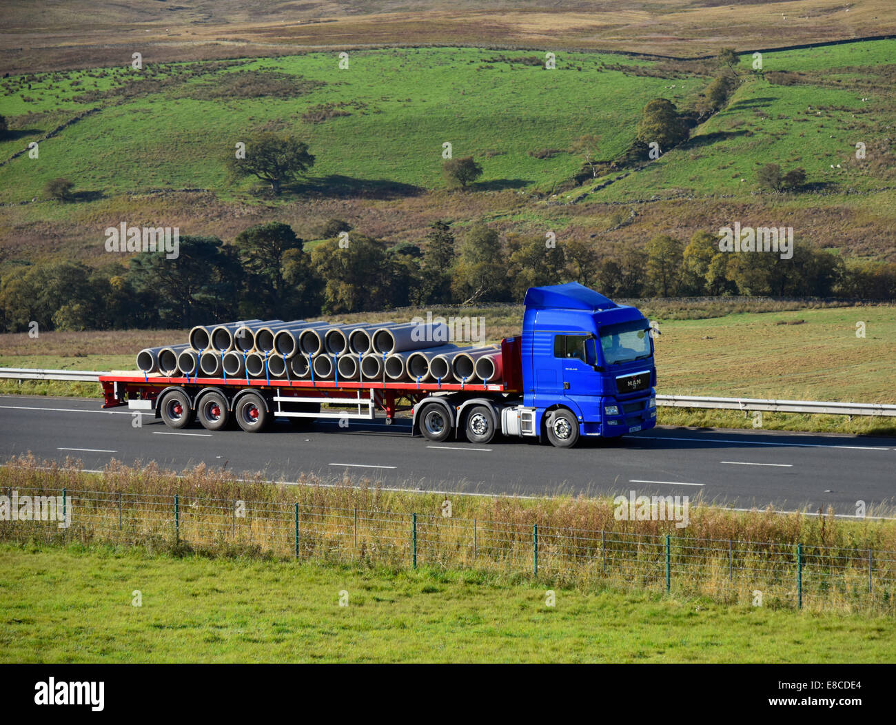 hgv-with-load-of-concrete-pipes-m6-motorway-northbound-shap-cumbria-E8CDE4.jpg