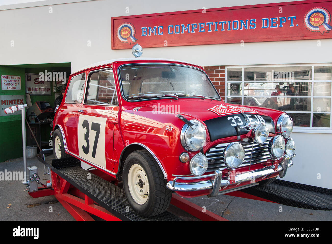 Classic vintage red BMC Mini Cooper racing car at the Goodwood Revival 2014, West Sussex, UK - Stock Image