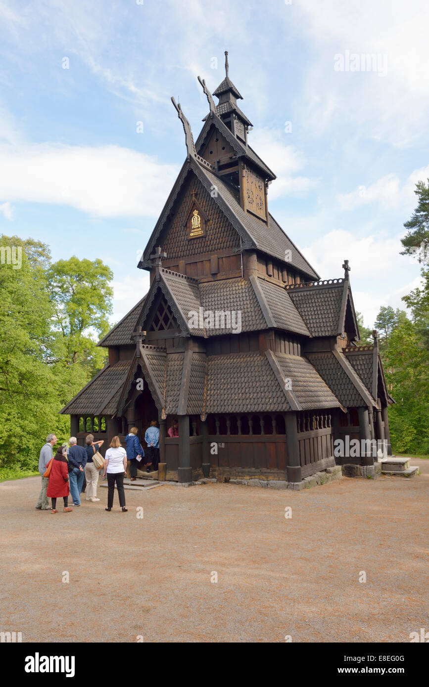 Tourists entering Gol Stavkirka c.1200, Folk/Cultural History Museum, Oslo, Norway 140820_62540 - Stock Image