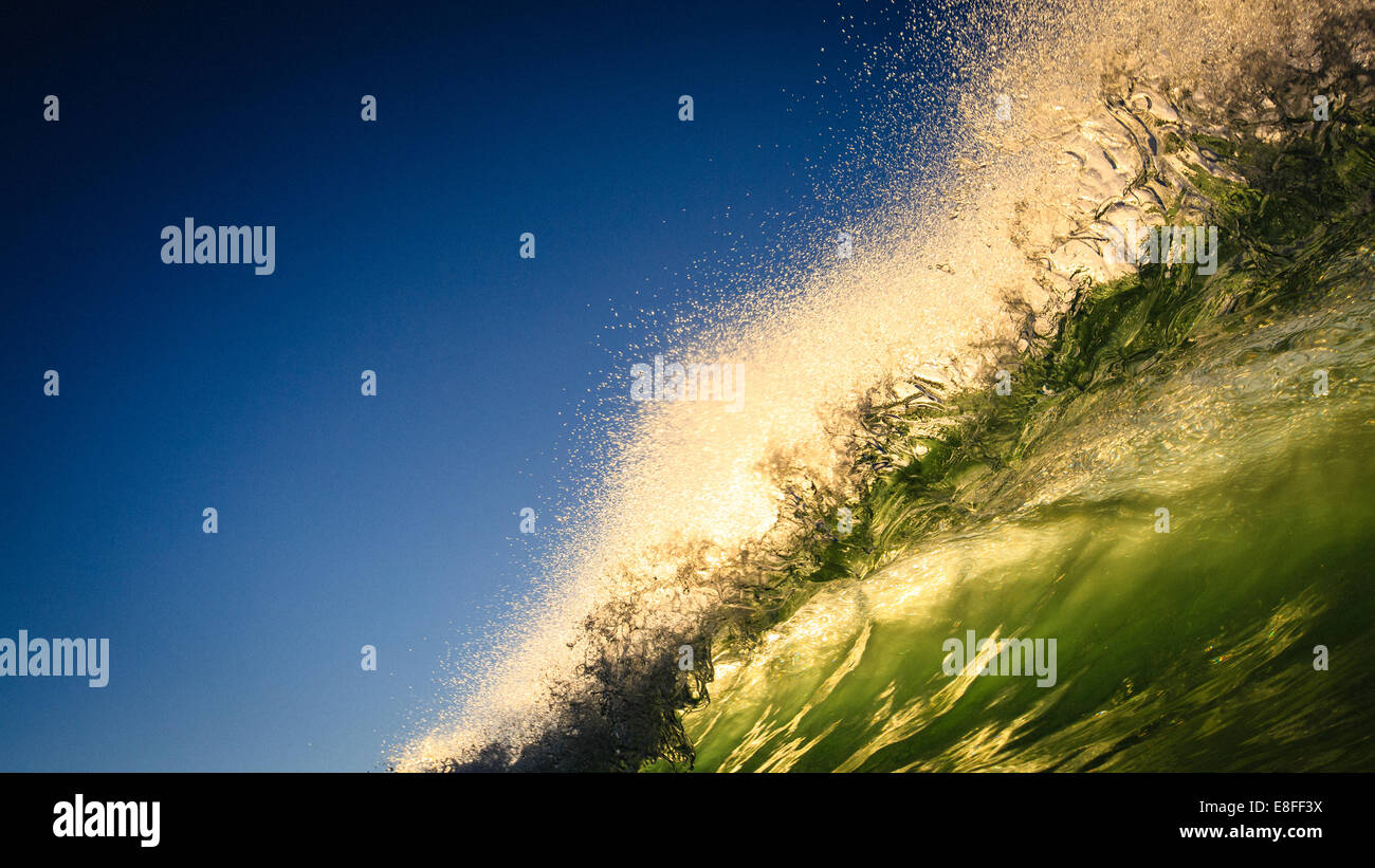 Close up of large wave with spray - Stock Image
