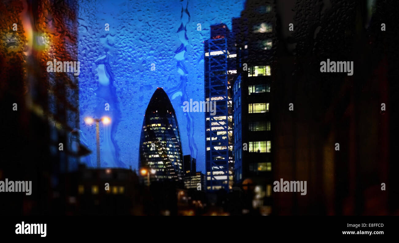 UK, London, Cityscape with Gherkin at dusk - Stock Image