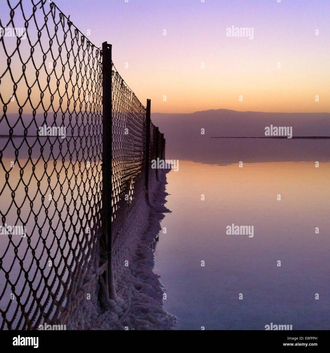Salt deposits on fence, Dead Sea, Israel - Stock Image