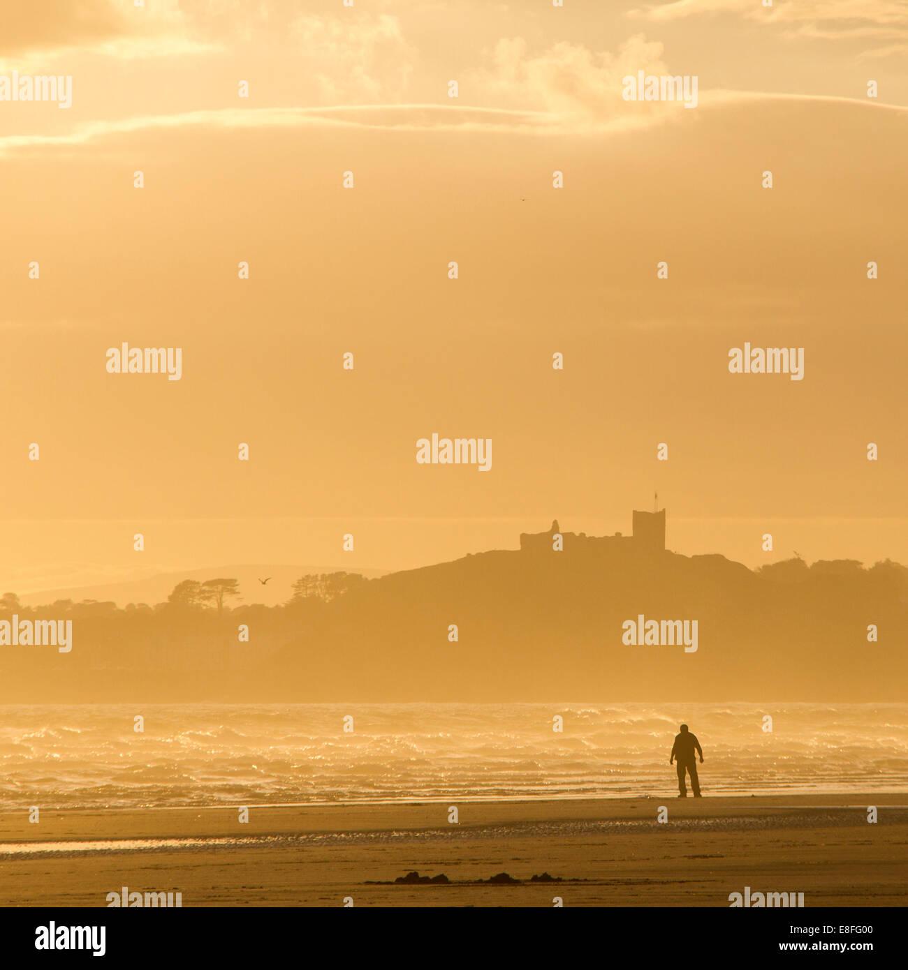 Man alone on beach - Stock Image