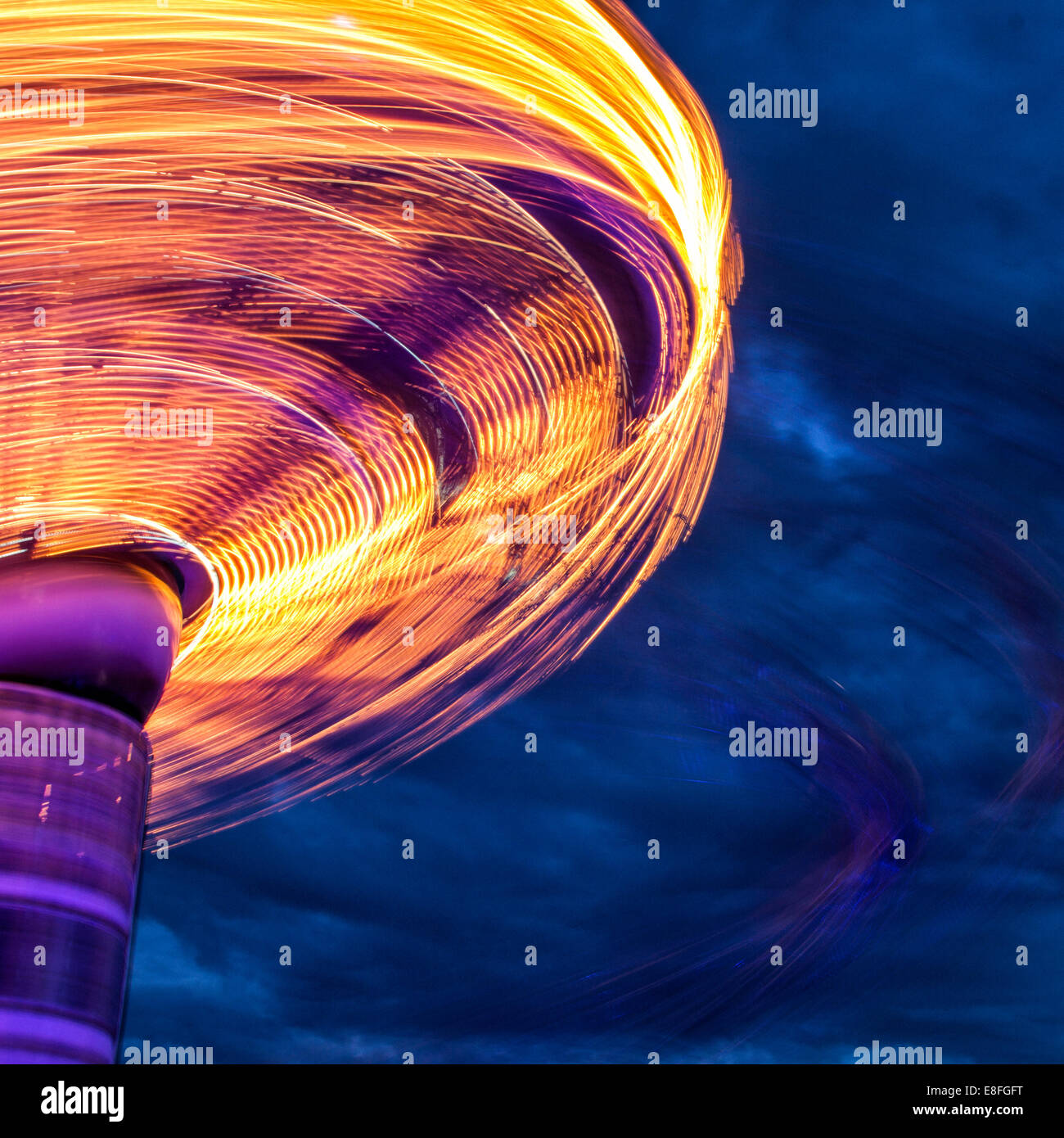 Blurred motion of carousel spinning - Stock Image