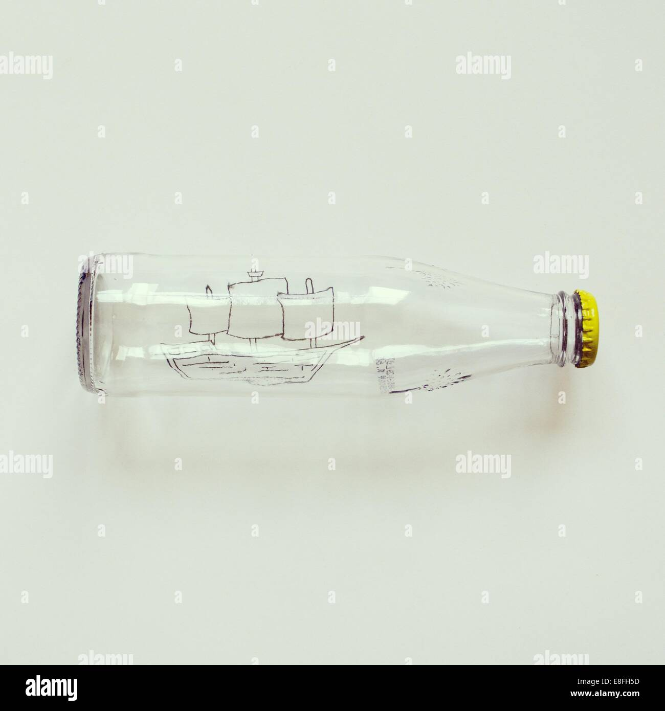 Conceptual ship in bottle - Stock Image