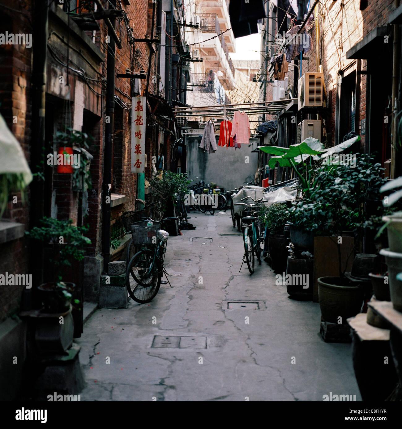 China, Shanghai, Narrow street - Stock Image