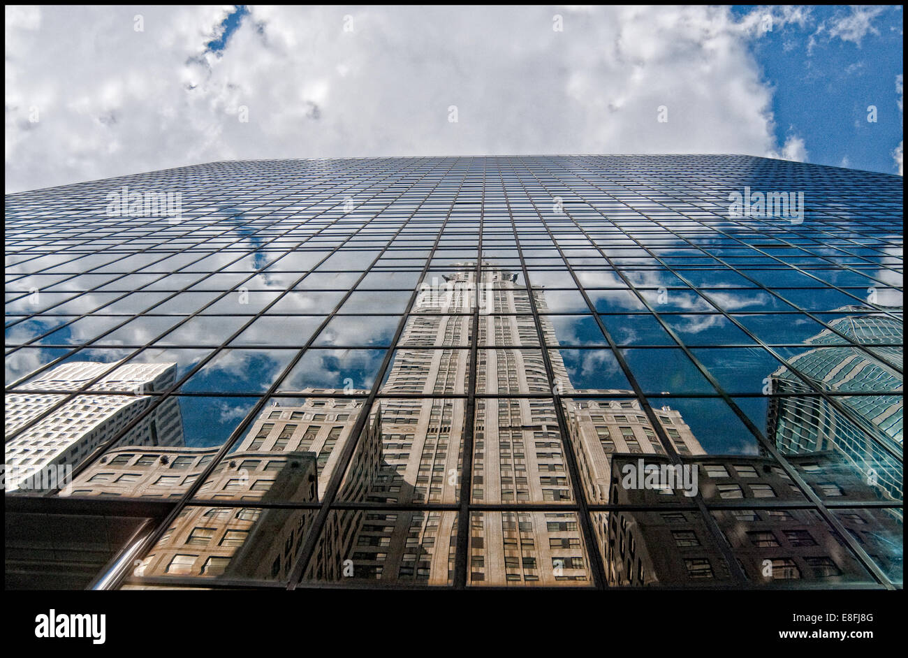 Chrysler building and skyscraper reflections in glass building, New York, america, USA - Stock Image