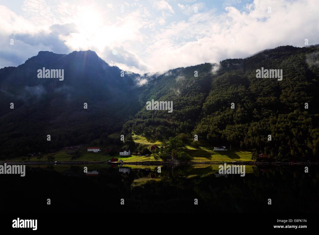 Summersun shining on houses - Stock Image