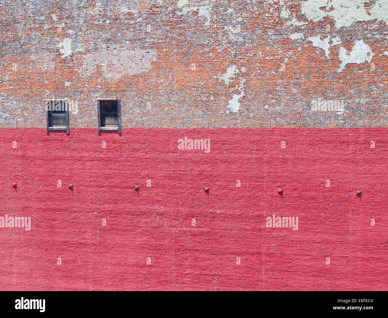 Brick wall with peeling paint - Stock Image
