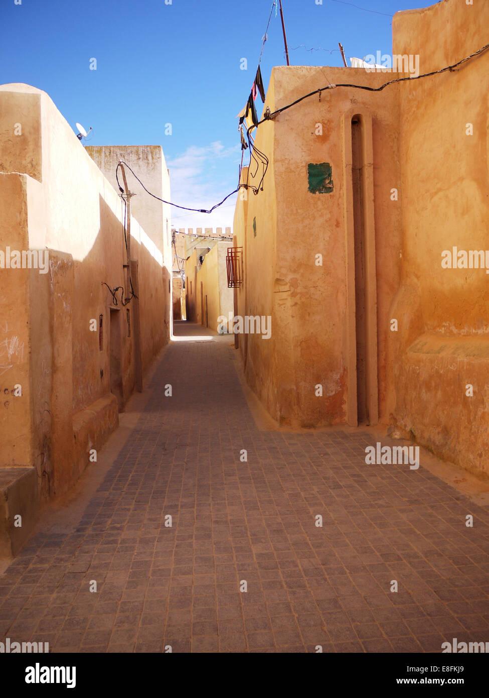 Empty alley between buildings, Morocco - Stock Image