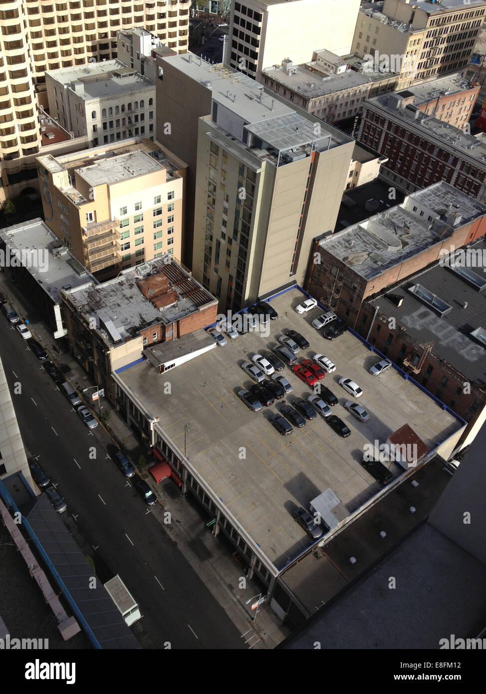 USA, California, San Francisco, Rooftop car park and city buildings - Stock Image