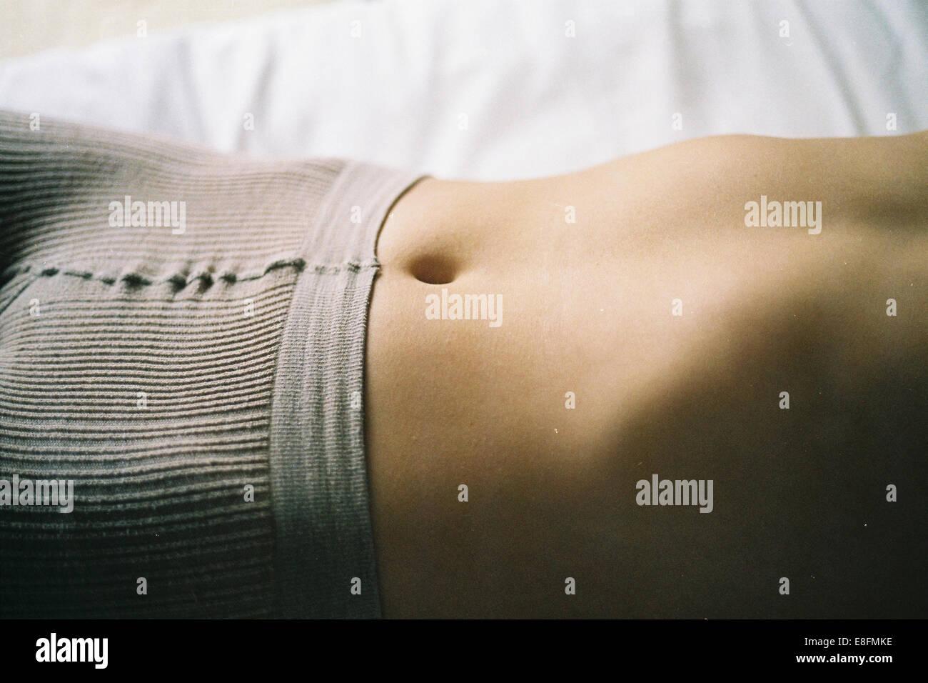 Female abdomen - Stock Image
