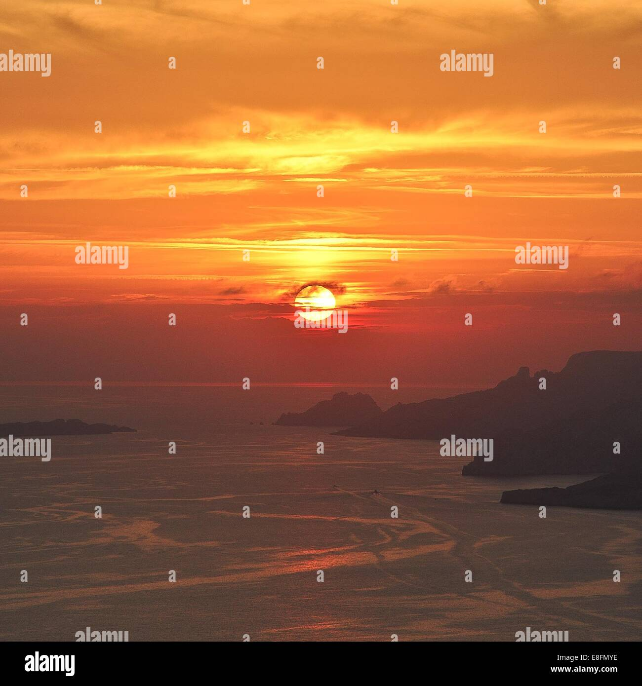 France, Provence-Alpes-Cote d'Azur, Bouches-du-Rhone, Marseille, Cassis, Sunset over sea - Stock Image