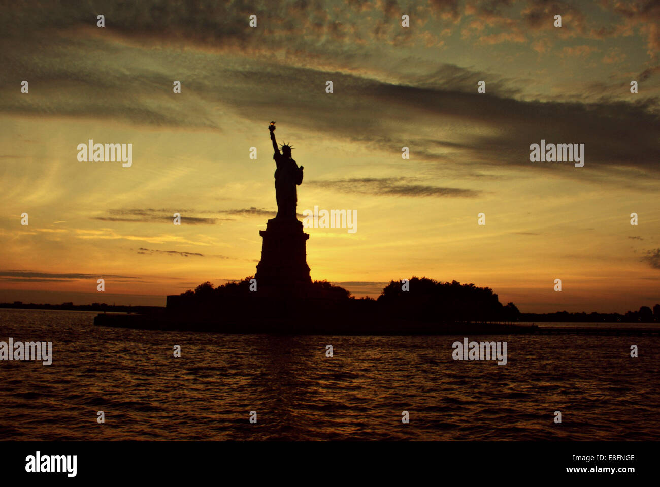 USA, New York State, New York City, Statue of Liberty at sunset - Stock Image