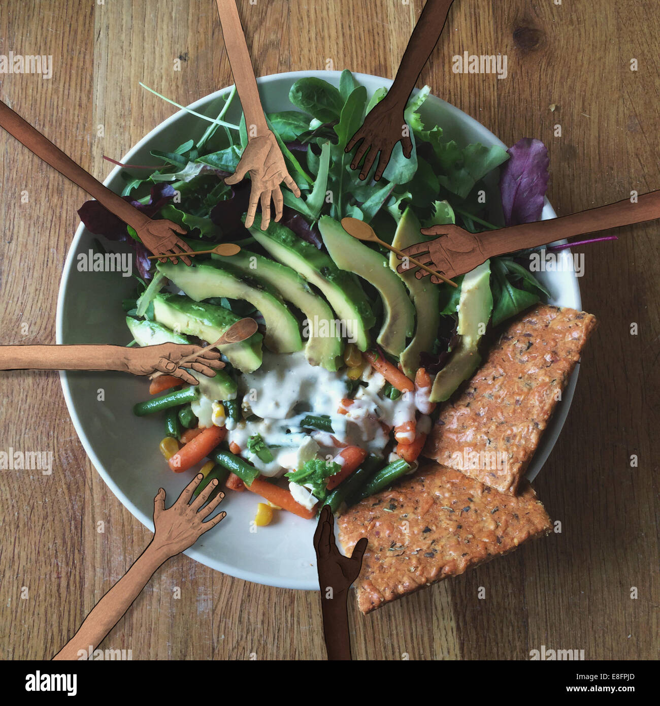 Human hands grabbing a healthy salad - Stock Image