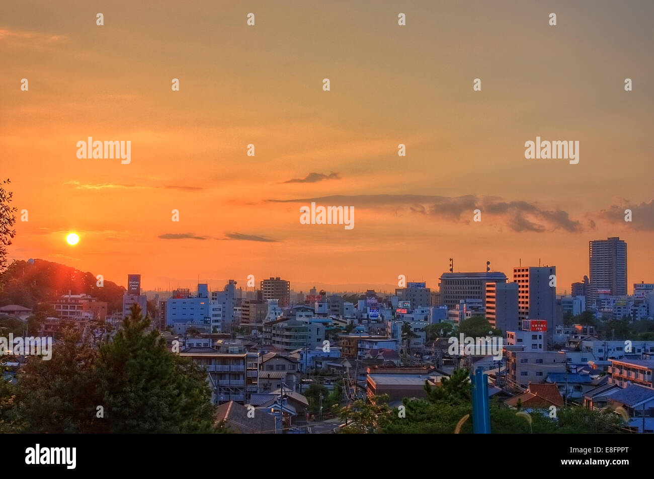 Sunset over city skyline, Okazaki, Chita, Japan - Stock Image