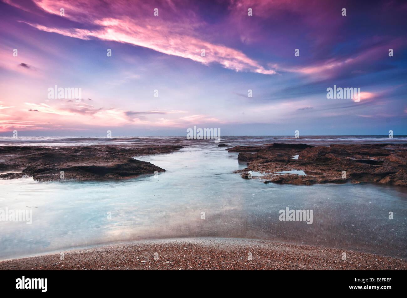 Israel, Tel Aviv District, Tel Aviv, Sunset on Beach - Stock Image