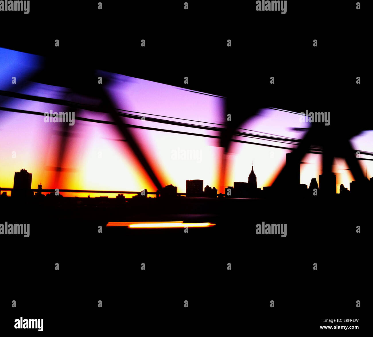 USA, New York City, Manhattan, Colored bridge and city skyline - Stock Image