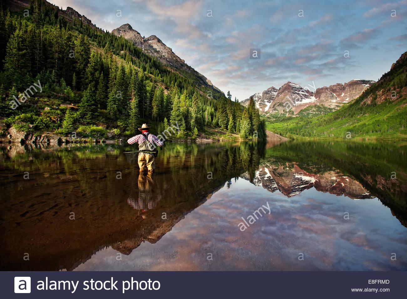 Fly fisherman angling in Maroon Lake, Colorado, America, USA - Stock Image