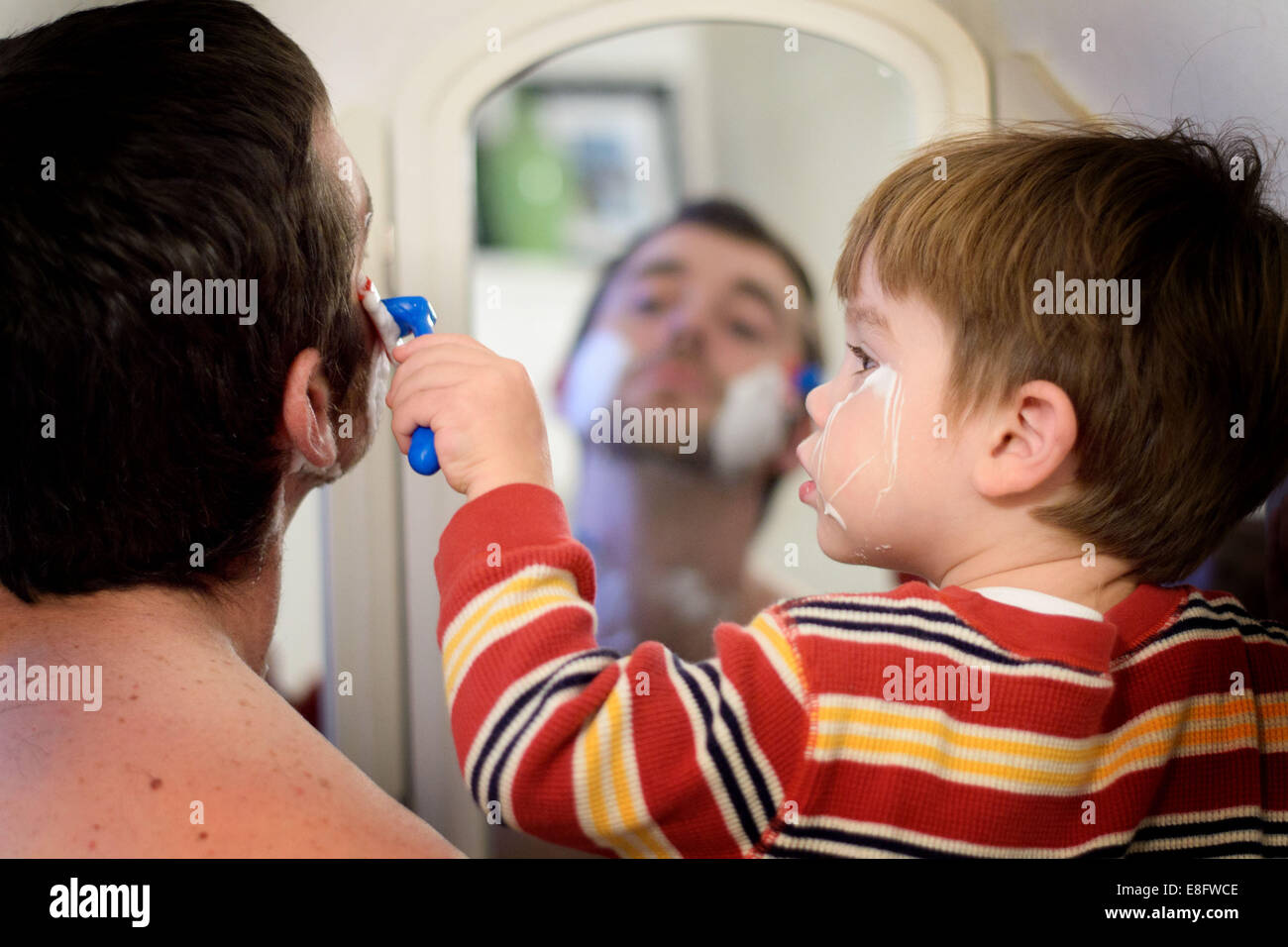 Father and son shaving (2-3 years) - Stock Image