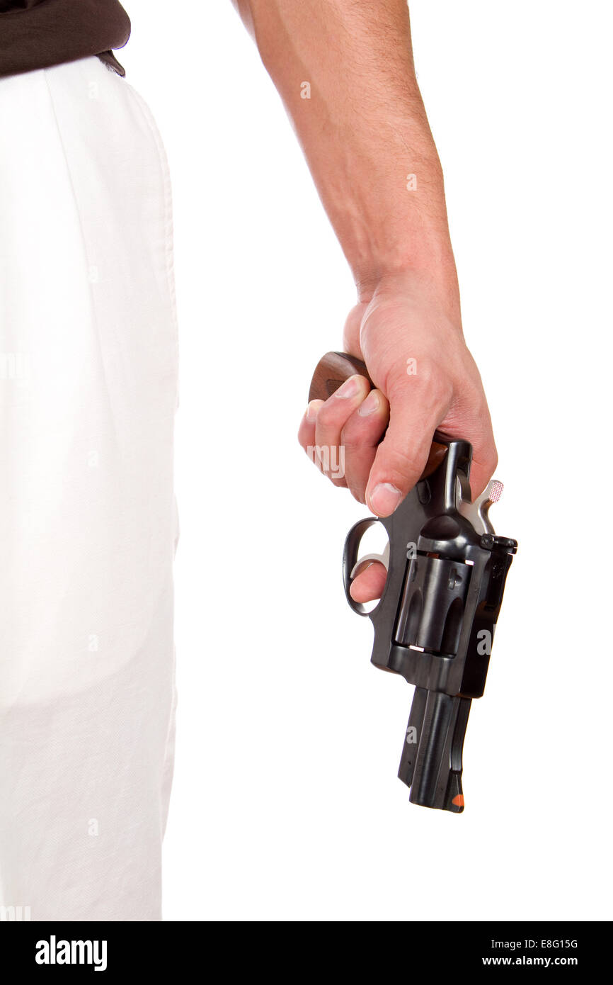 Violent man holds a 357 magnum revolver at his side with his finger on the trigger. - Stock Image