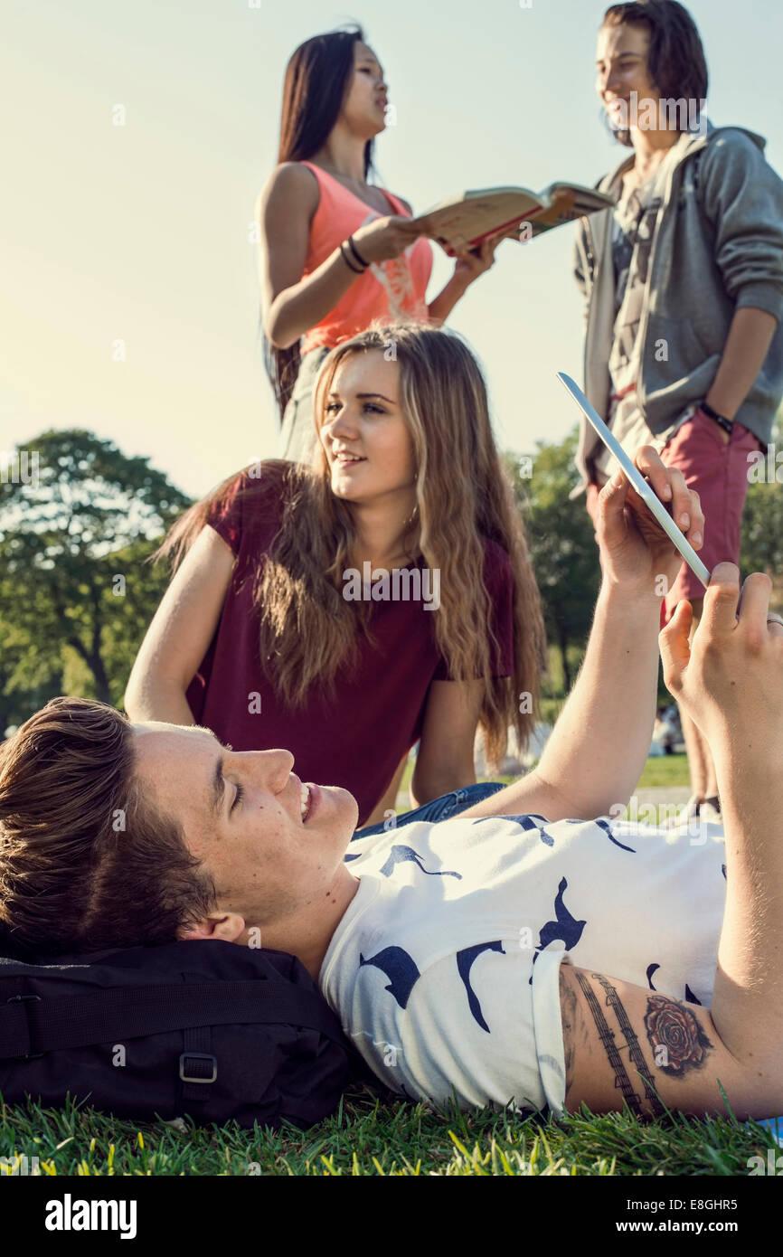 Teenage students spending leisure time on high school schoolyard - Stock Image