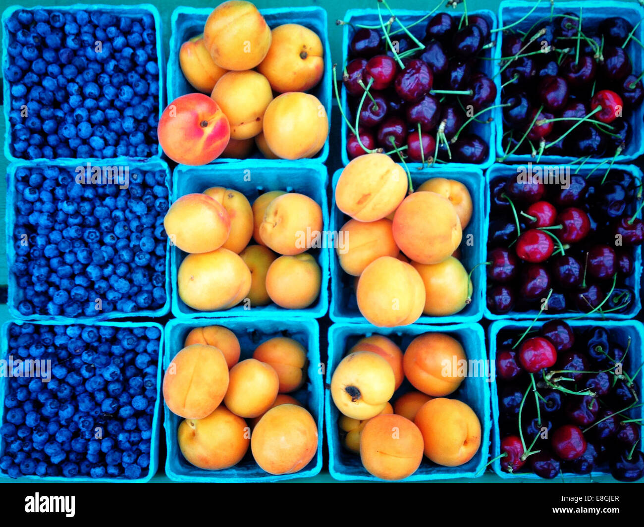 Overhead view of punnets of fruit - Stock Image