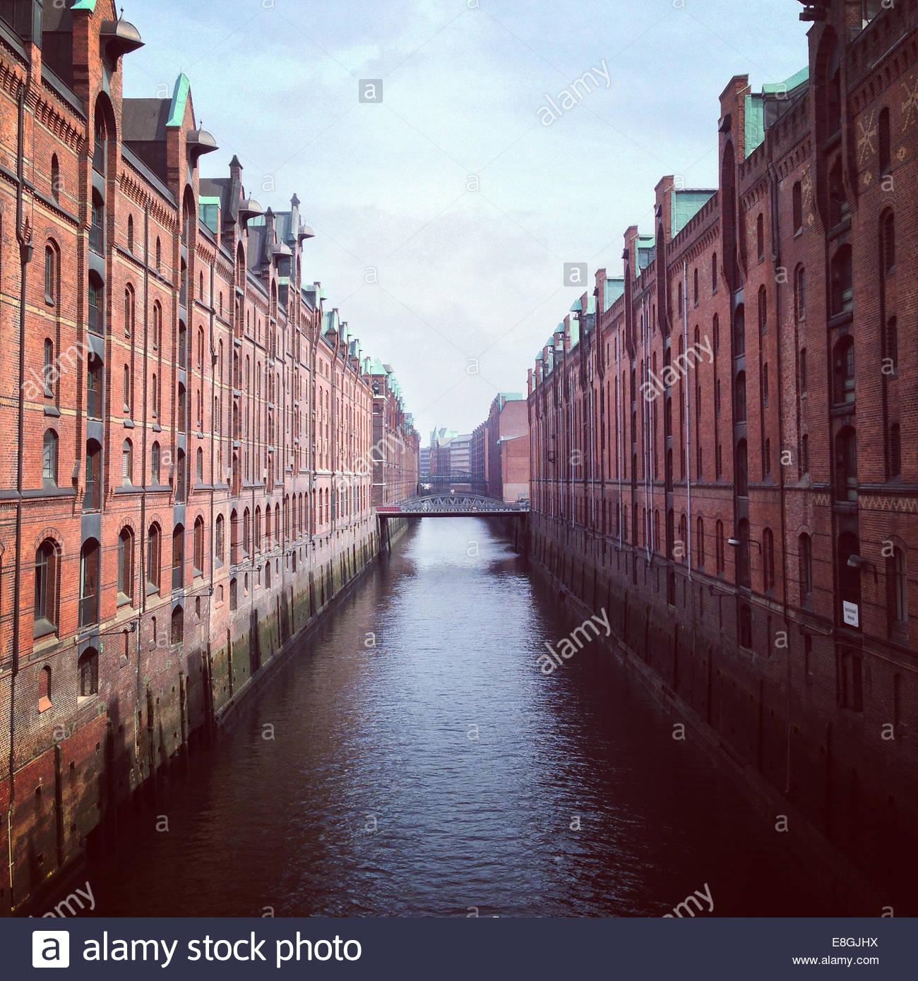 Canal between buildings, Hamburg, Germany - Stock Image