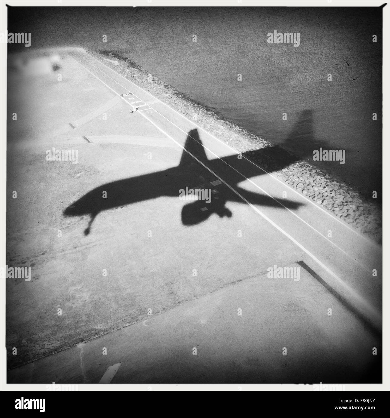 Shadow of airplane flying - Stock Image