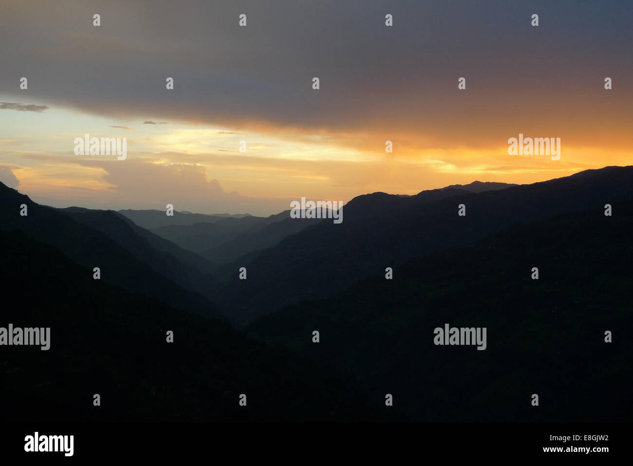 Sunset behind hills - Stock Image