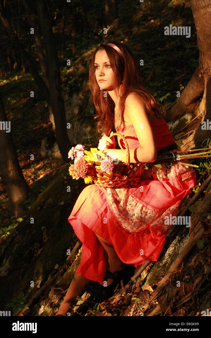 Girl (12-13) with Basket of Flowers - Stock Image
